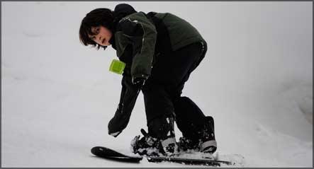 fifth grader snowboarding