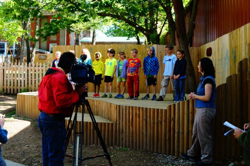 "First grade Rainbow students sing the ""Water Cycle"" song as they are filmed by WLOS."