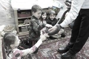 petting the black rat snake
